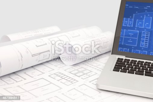 istock Architecture design project blueprints with interactive laptop computer 457394511