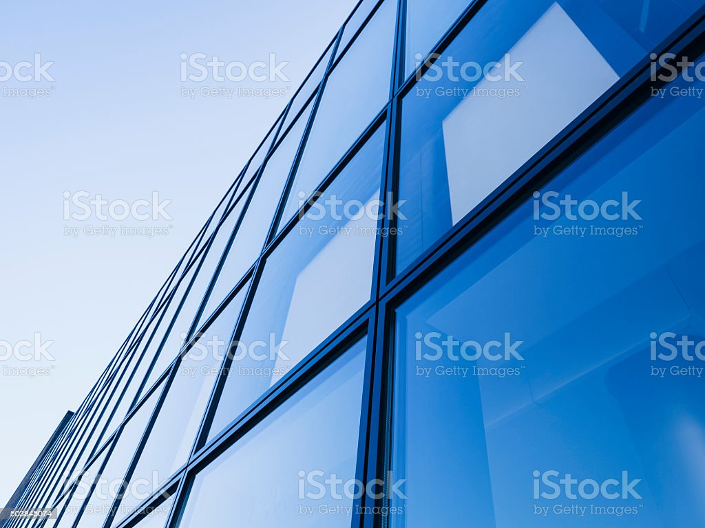 Architecture detail Modern Glass facade Blue tone stock photo