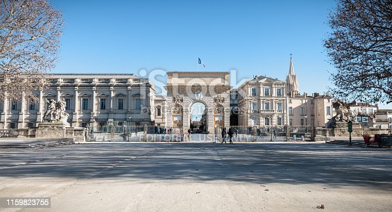 Montpellier, France - January 2, 2019: Architecture detail of the Arc de Triomphe and its street atmosphere on a winter day