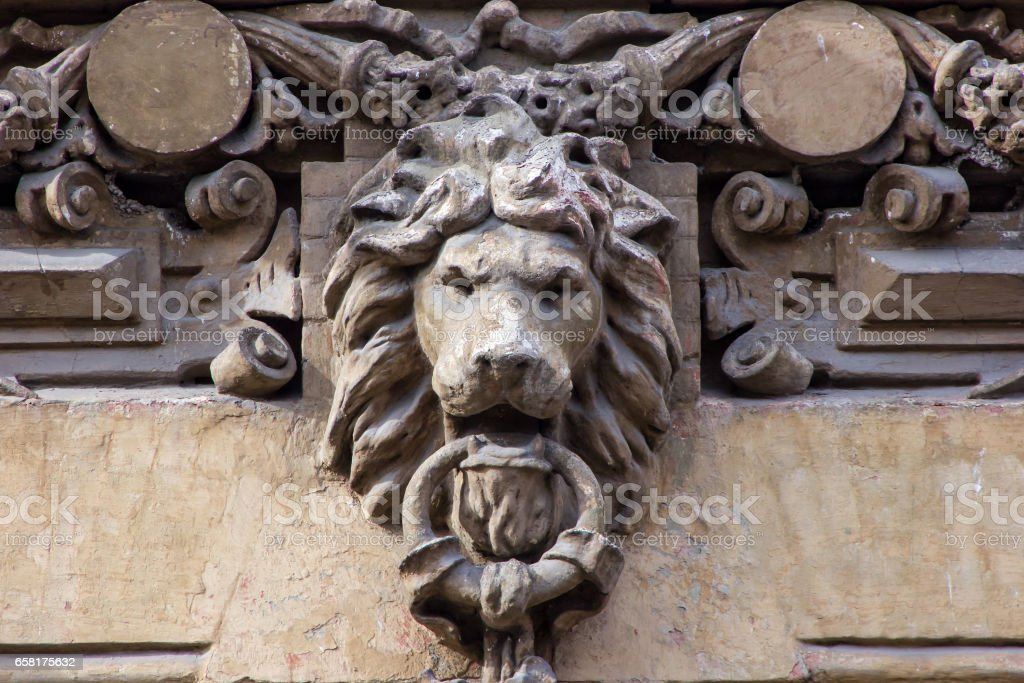 architecture detail with lion's head stock photo