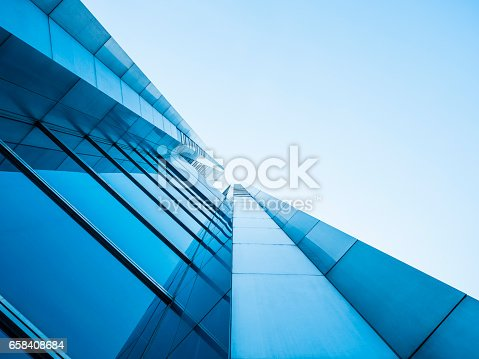 511118930 istock photo Architecture details Modern Building Glass facade design 658408684