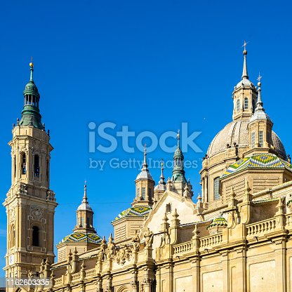Architecture details of the cupolas and tower bell of Cathedral of Our Lady of the Pillar in Zaragoza, a fine example of Baroque style architecture