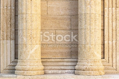 istock Architecture, elements and details of the building. Background with classic columns against the wall. 1058366234