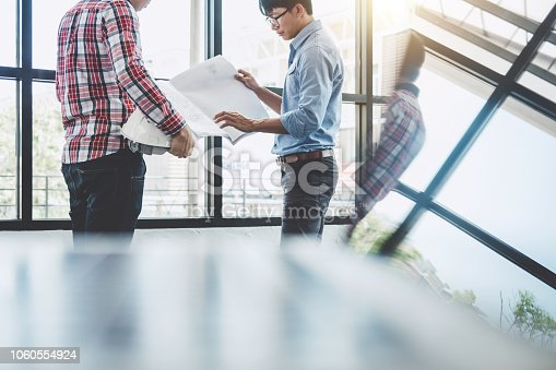 1071990712 istock photo Architecture Engineer Teamwork Meeting, Drawing and working for architectural project and engineering tools on workplace, concept of worksite on technical drawing 1060554924