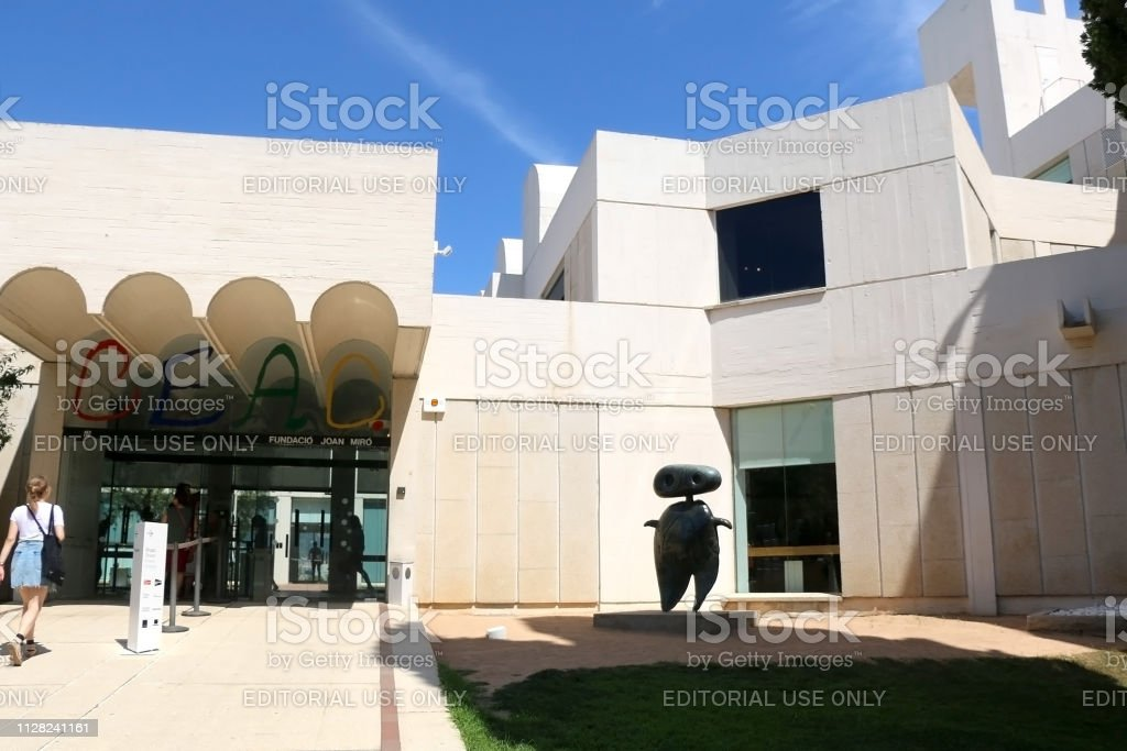 Architecture in Barcelona, Spain Barcelona, Spain - July 8, 2018: Visitors at Joan Miró Foundation (Fundació Joan Miró), a museum of modern art honoring artist Joan Miró, located on the hill Montjuïc in Barcelona, Spain. Abstract Stock Photo