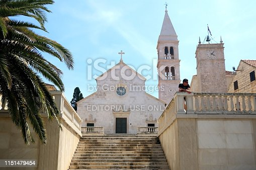 Supetar, Croatia - May 27, 2018: Tourist in front of historical Church of Mary Annunciation, landmark in Supetar, island Brac, Croatia.