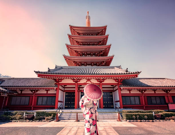 Architecture in Tokyo February 2019 - Tokyo, Japan - Girl with traditional dress in Senso-ji temple in Asakusa, Tokyo bodhisattva stock pictures, royalty-free photos & images