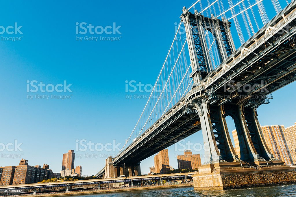 NYC Architecture Manhattan Bridge Low Angle View From East River stock photo