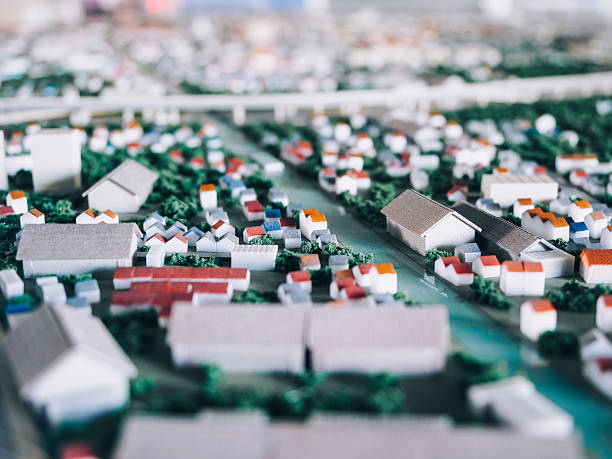 architecture model city plan tilt shift blur effect - figurine stock photos and pictures