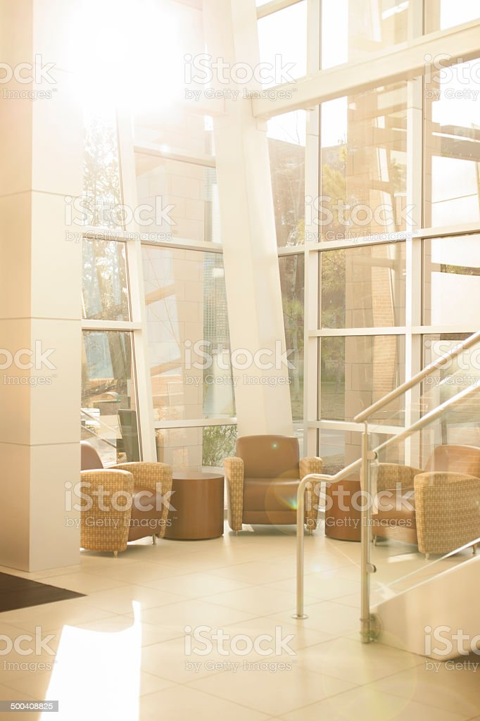 Architecture: Modern Office Lobby. Glass, Steel Staircase, Windows. Chairs.  Royalty