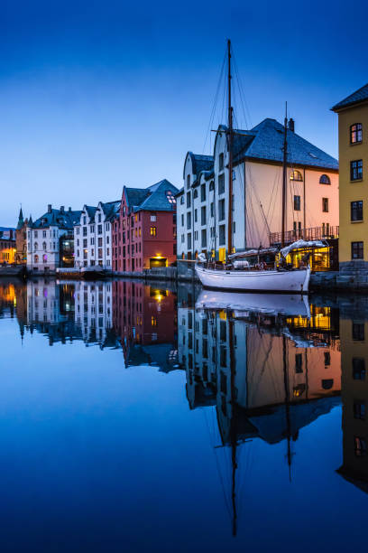 Architecture of Alesund town at night in Norway stock photo
