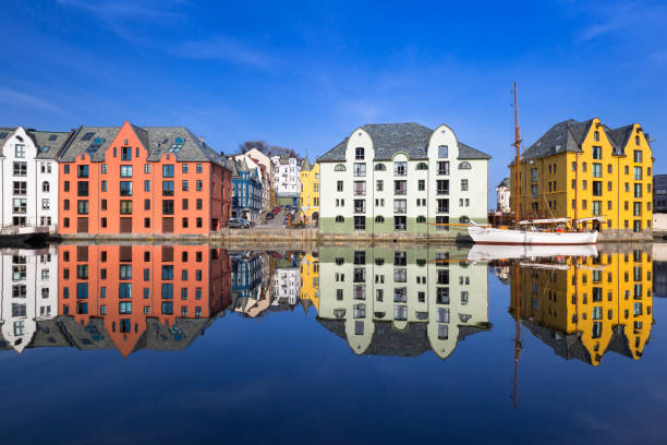 Architecture of Alesund town reflected in the water stock photo