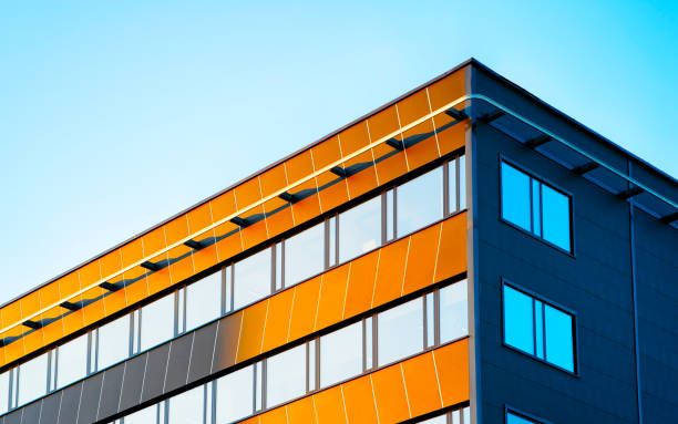Architecture of modern corporate business office building blue sky reflex stock photo