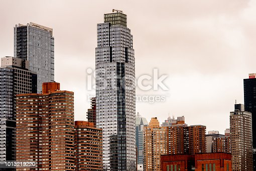 istock Architecture of New York on a cloudy day, NY, United Sates of America 1013219220