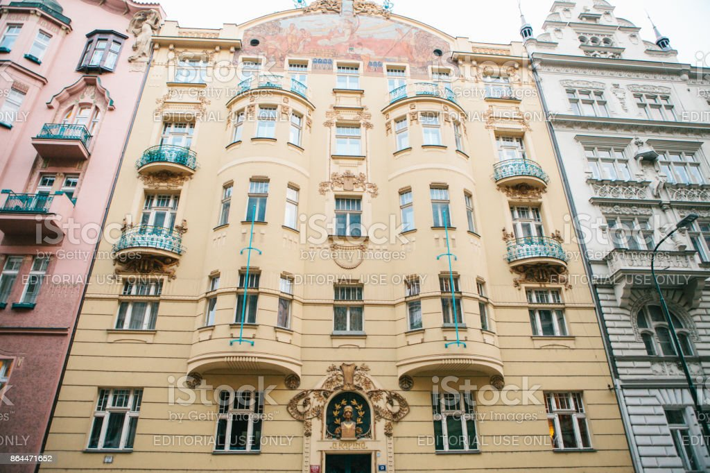 Architecture of Prague. Luxurious old houses of different colors stand closely next to each other with decor elements and balconies stock photo