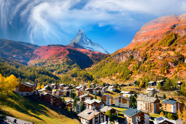 Architecture of Switzerland near Matterhorn Autumn resort slopes and bright beautiful landscape with the famous Matterhorn peak in autumn in Switzerland. Original beautiful houses of the Swiss highlanders on a moonlit night zermatt stock pictures, royalty-free photos & images