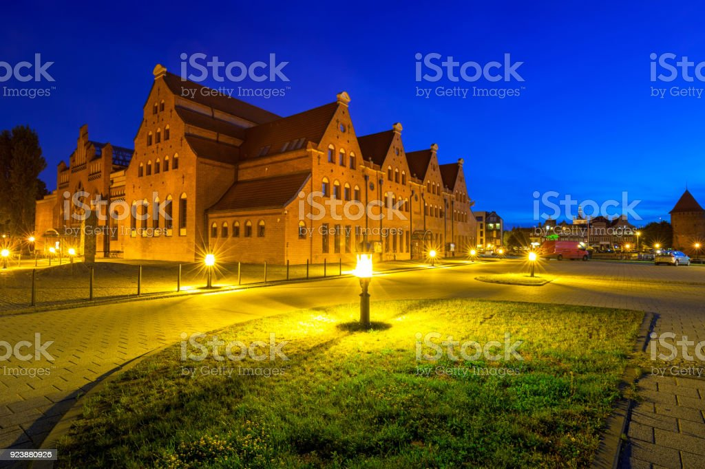 Architecture of the Baltic Philharmonic in Gdansk at night stock photo