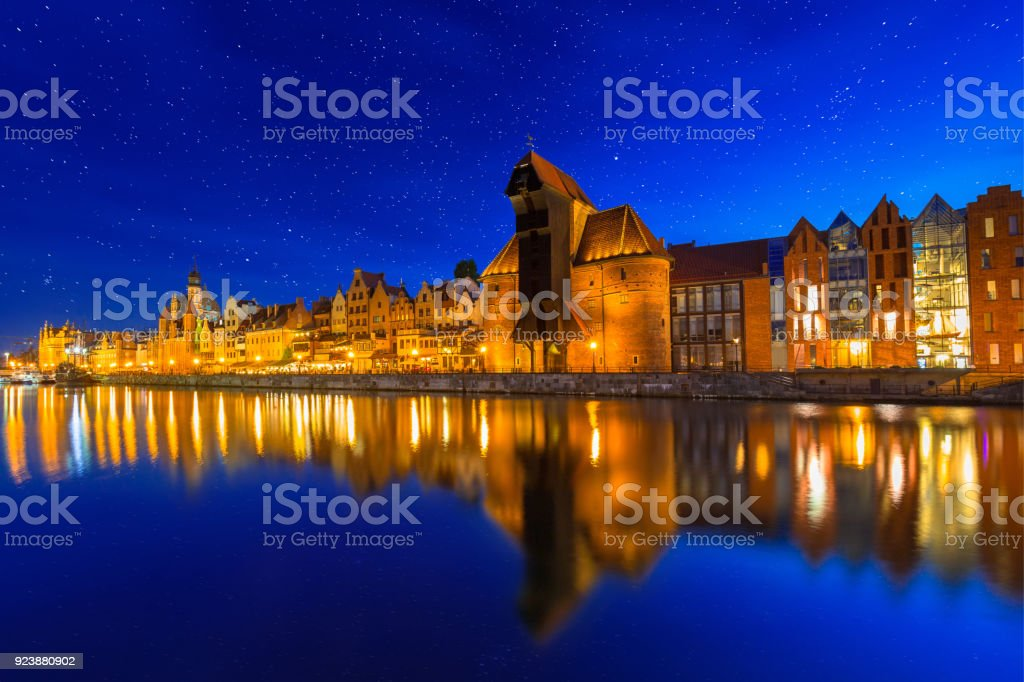 Architecture of the old town in Gdansk over Motlawa river at dusk stock photo