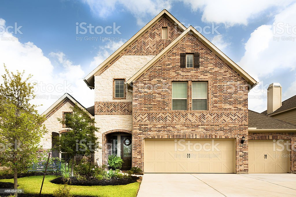 Architecture, Real Estate:  New brick, stone home. Texas suburban neighborhood. stock photo