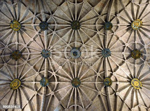 Ceiling of the Jeronimos monastery in Lisbon; Portugal - ribbed vault resulting from the intersection of barrel vaults - Portuguese heraldic - UNESCO world heritage site - Portuguese late Gothic, known as Manueline style - Lierne vault with bosses - Mosteiro dos Jeronimos, Belem