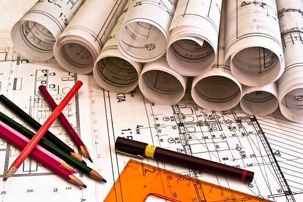 Architecture rolls architectural plans project architect blueprints stock photo