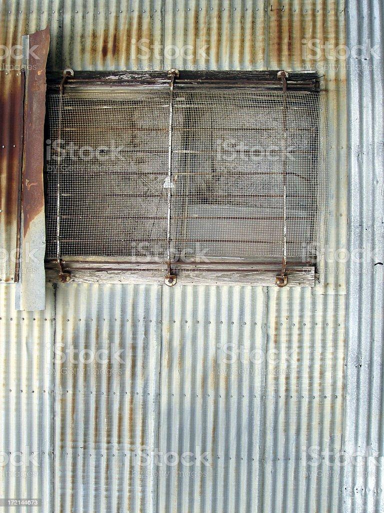 Architecture - Rusty window & siding stock photo
