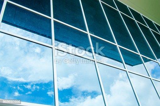 533437662 istock photo Architecture window modern sky reflection 868692556