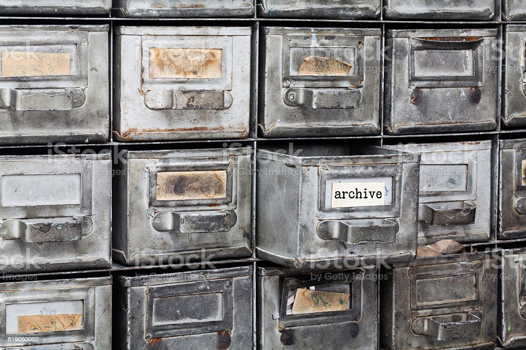 Archive old style interior. Closed metallic storage, filing cabinet. aged stock photo