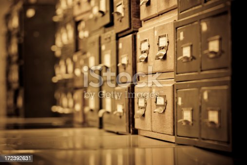 Antique wooden storage boxes in a Archive