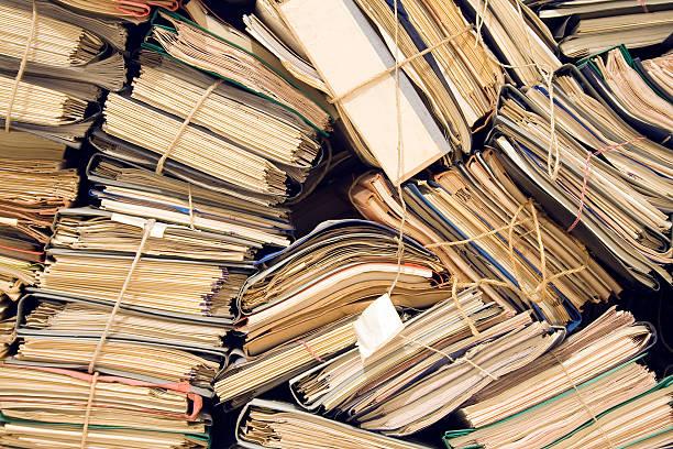archive with neglected, old files - paper mass bildbanksfoton och bilder