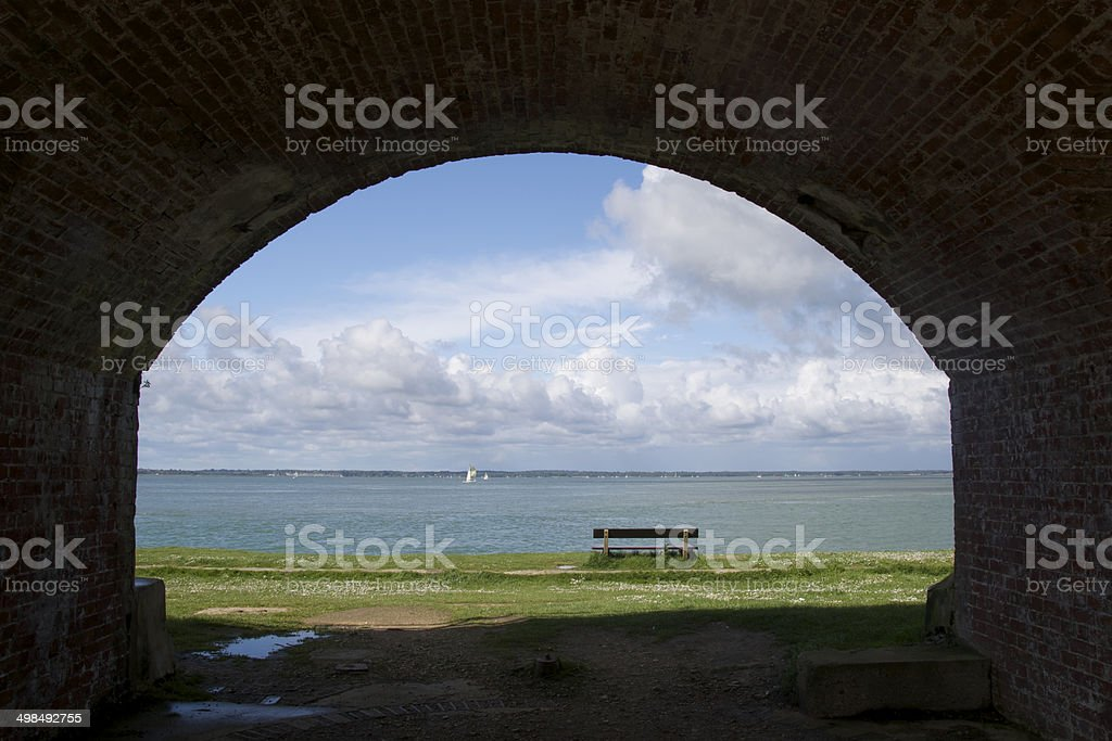Archway and bench at Fort Victoria overlooking the Solent stock photo