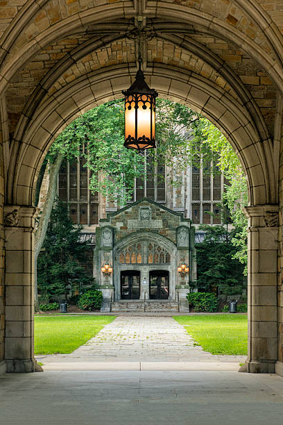 Archway to the University of Michigan Law School Campus Archway to the campus of the University of Michigan Law School. On the far back you can see the Cook Legal Research Building. It has a beautiful entrance which leads to the huge reading room with its magnificant doors and interior,  spires and stained glass windows.  ann arbor stock pictures, royalty-free photos & images