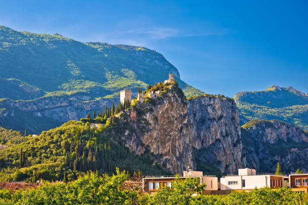 Arco castle ruins on cliffs above Garda lake, Trentino Alto Adige region of Italy Arco castle ruins on cliffs above Garda lake, Trentino Alto Adige region of Italy trentino alto adige stock pictures, royalty-free photos & images