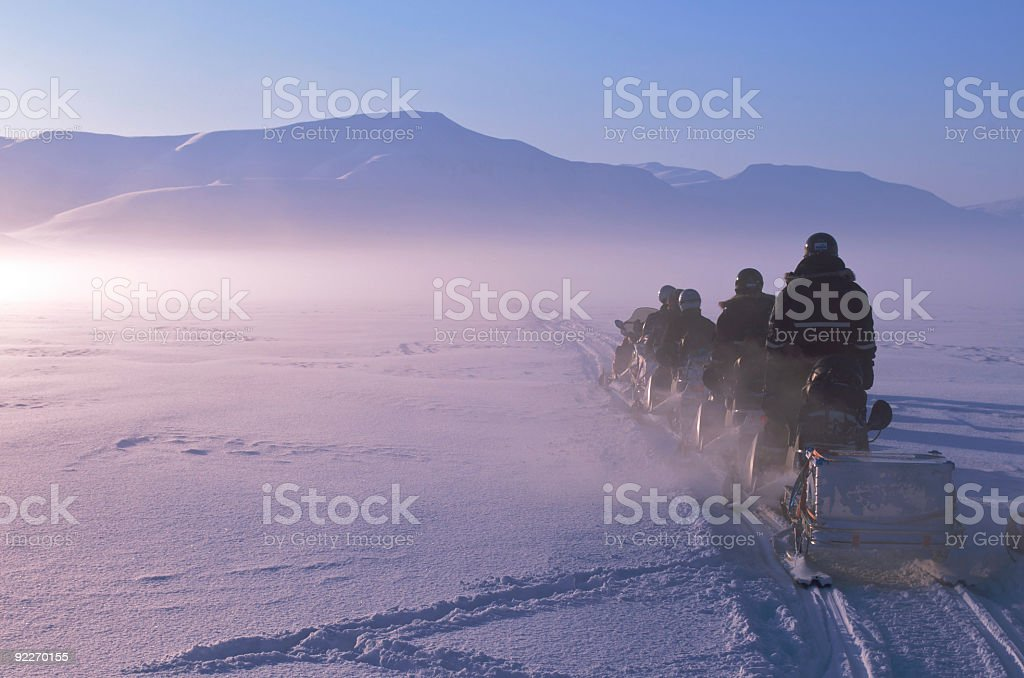 Arctic Expedition on Snowmobiles in Spitzbergen, Norway stock photo
