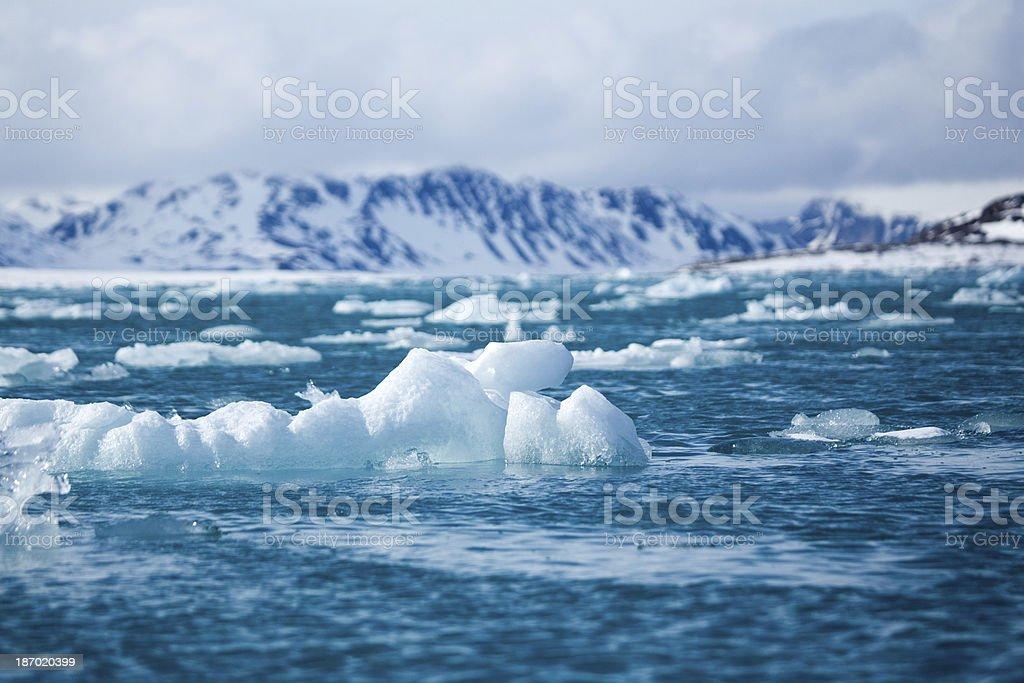 Arctic glacier iceberg blue ice in Svalbard stock photo