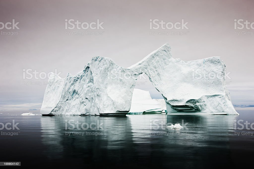 Arctic Iceberg with Natural Arch West Greenland  Arctic Stock Photo