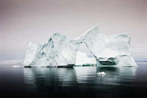 Arctic Iceberg With Natural Arch West Greenland Stock Photo - Download Image Now