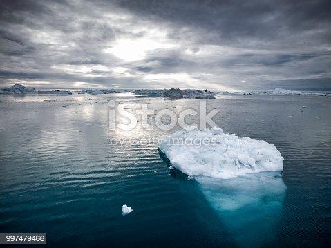 Beautiful arctic Iceberg drifting in the Arctic Ocean at twilight close to sunset. Disko Bay, Ilulissat, Western Greenland. Hasselblad 50 MPixel XXL Shot.