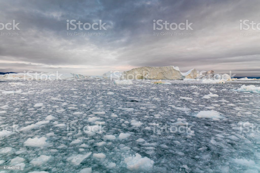 Arctic Icebergs in Greenland Ilulissat Ice Fjord at Sunset Twilight royalty-free stock photo