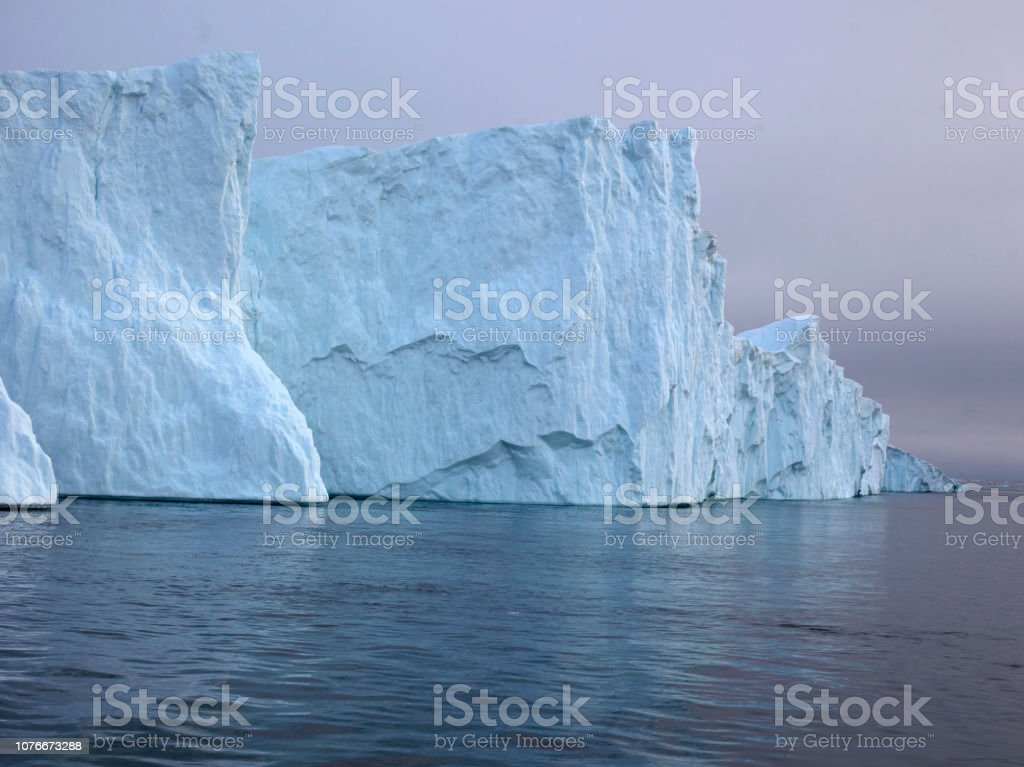 Arctic Icebergs Greenland in the arctic sea. You can easily see that...