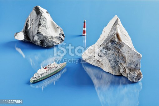 Tabletop shot with historic miniature model of passenger ship and two flints
