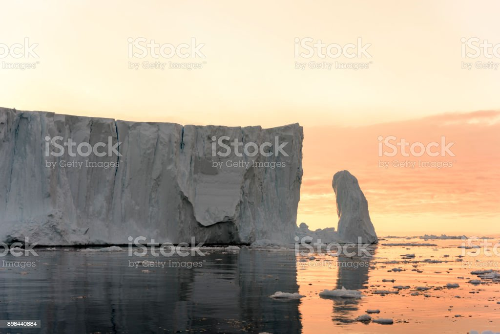 Arctic Icebergs with sunset on Arctic Ocean in Greenland. Climate...