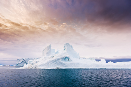 Arctic Moody Sunrise Iceberg North West Greenland Stock Photo - Download Image Now