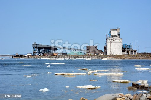 Arctic shipping port with ice on water