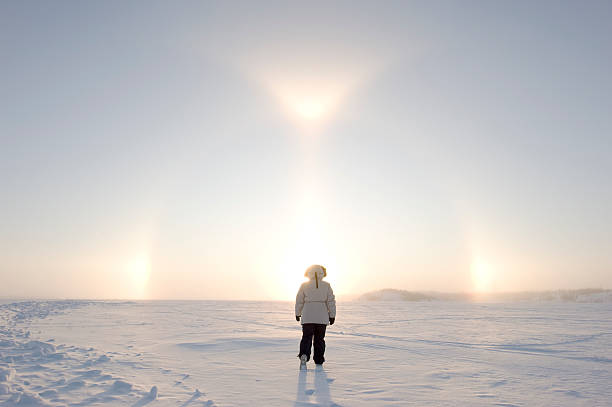 Arctic Sundogs or Parhelion with Woman in parka. stock photo