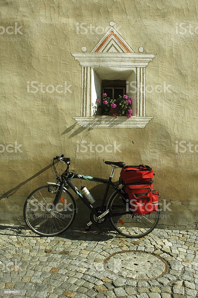 Ardez (Engadine, Switzerland) - Old typical house and a bicycle royalty-free stock photo
