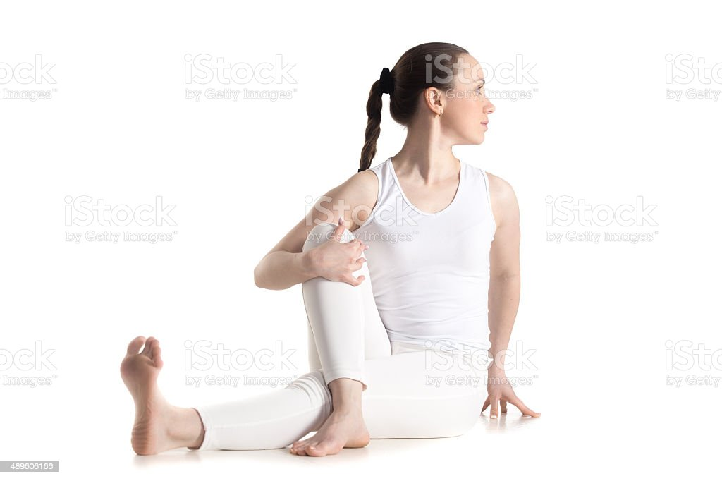 Ardha Matsyendrasana yoga pose stock photo