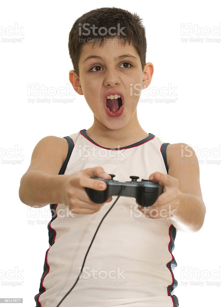 Ardor boy is playing a computer game with joystick royalty-free stock photo