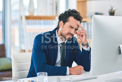 913327640 istock photo Are migraines causing the quality of your work to suffer? 1245040074