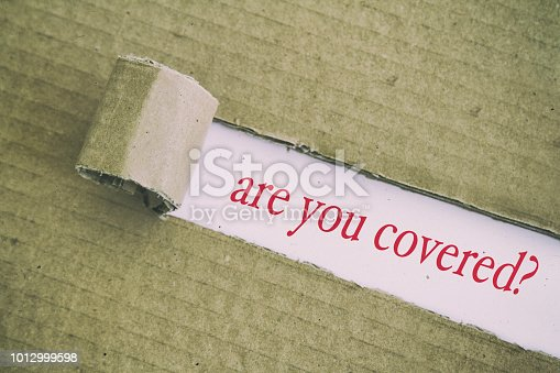 are you covered? written under torn paper.